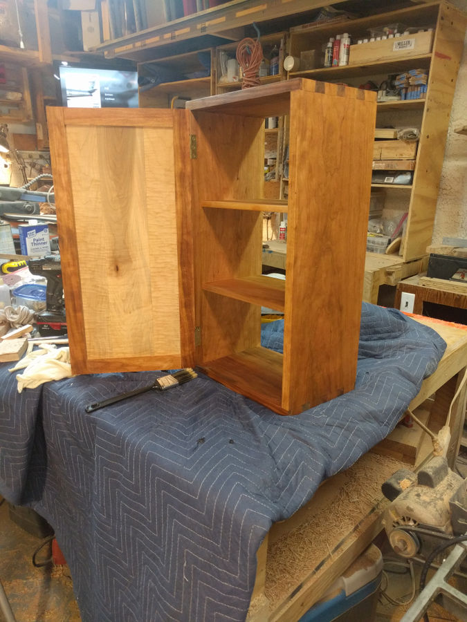 Photo of Dovetail wall cabinet in cherry and curly maple