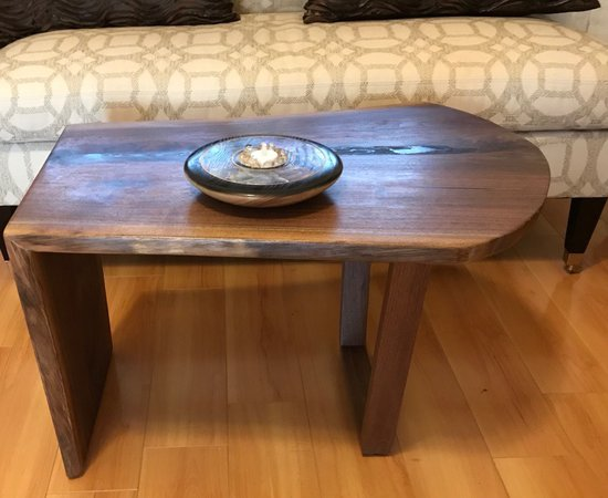 Waterfall lie-edge coffee table