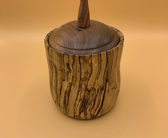 Lidded box in spalted mango with a walnut lid