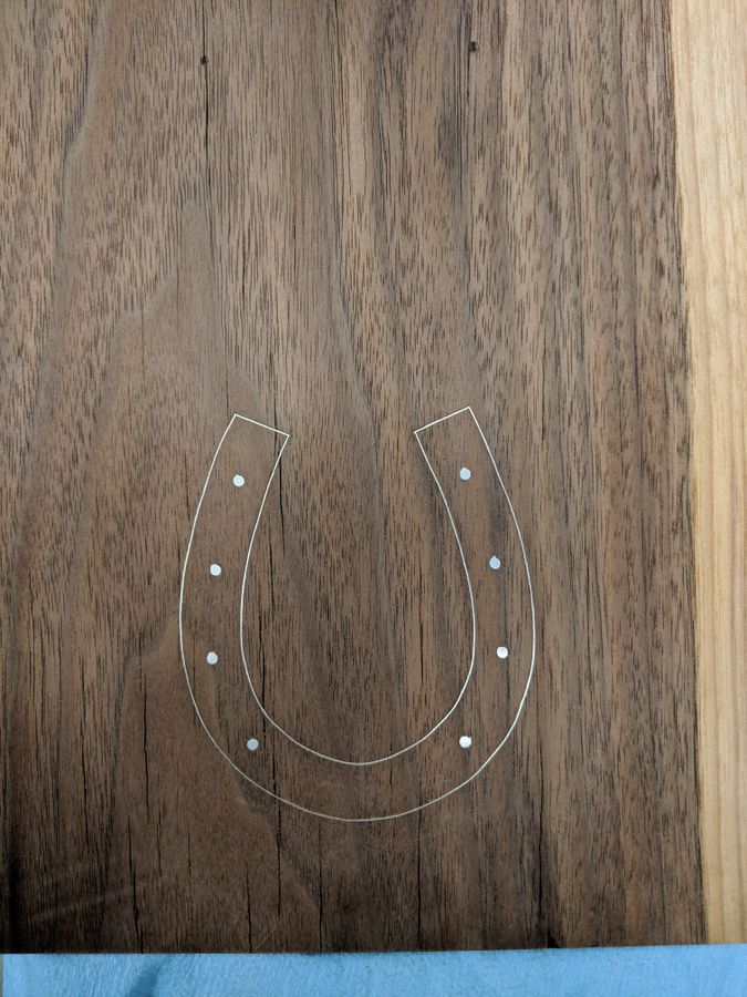 Photo of Magnetic Bottle Opener With Wire Inlay