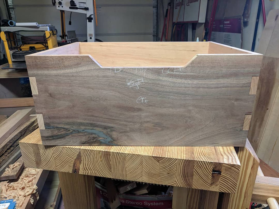 Photo of Walnut and cherry storage bed