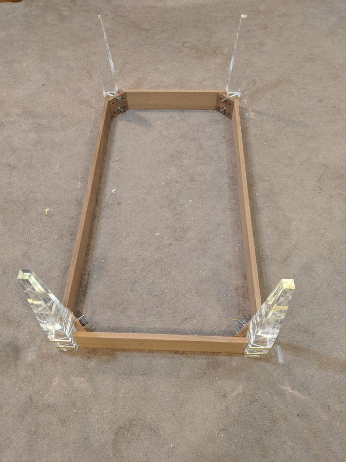 Photo of Ebonized Walnut Coffee Table With Brass Banded Acrylic Legs