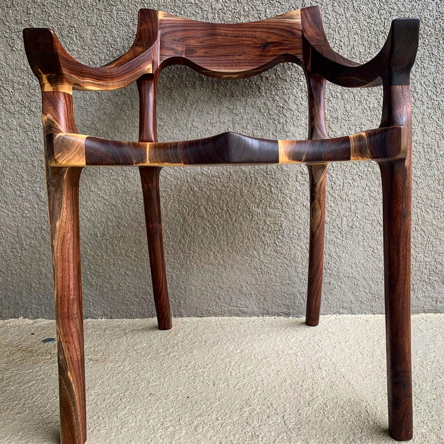Photo of Contrast walnut low back chair
